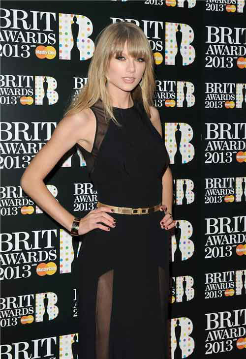 Taylor Swift wore a sexy black floor-length Elie Saab dress with sheer-paneled slits from the designer&#39;s Pre-Fall 2013 collection on the red carpet at the 2013 Brit Awards on Feb. 20, 2013. <span class=meta>(Richard Young &#47; startraksphoto.com)</span>