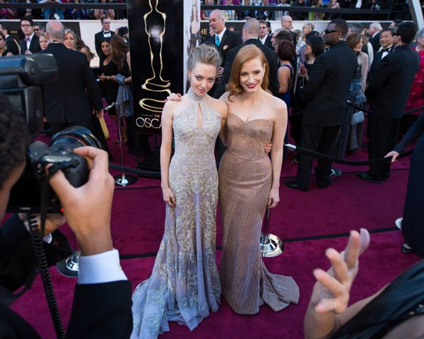 Amanda Seyfried (left) poses with Jessica Chastain, Oscar-nominee for Actress in a Leading Role, as they arrive for The Oscars at the Dolby Theatre in Hollywood on Sunday, Feb. 24, 2013.