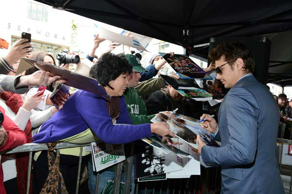 Actor James Franco signs autographs after a ceremony honoring him with a star on The Hollywood Walk of Fame on March 7, 2013 in Hollywood, California.  <span class=meta>(Alberto E. Rodriguez&#47;WireImage)</span>