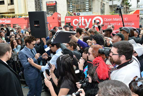 Actor James Franco signs autographs after a...