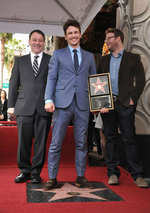 Director Sam Raimi, left, actor James Franco, center, and actor Seth Rogen appear at a ceremony honoring Franco with a star on the Hollywood Walk of Fame on Thursday, March 7, 2013 in Los Angeles. Franco and Rogen starred together in the comedy &#39;Pineapple Express,&#39; and Raimi directed Franco in &#34;Oz the Great and Powerful.&#34; <span class=meta>(John Shearer&#47;Invision&#47;AP)</span>