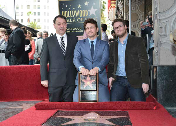 (L-R) Director Sam Raimi, actors James Franco and Seth Rogen attend a ceremony honoring James Franco with a star on The Hollywood Walk of Fame on March 7, 2013 in Hollywood, California.