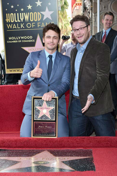 Actors James Franco (L) and Seth Rogen attend a...