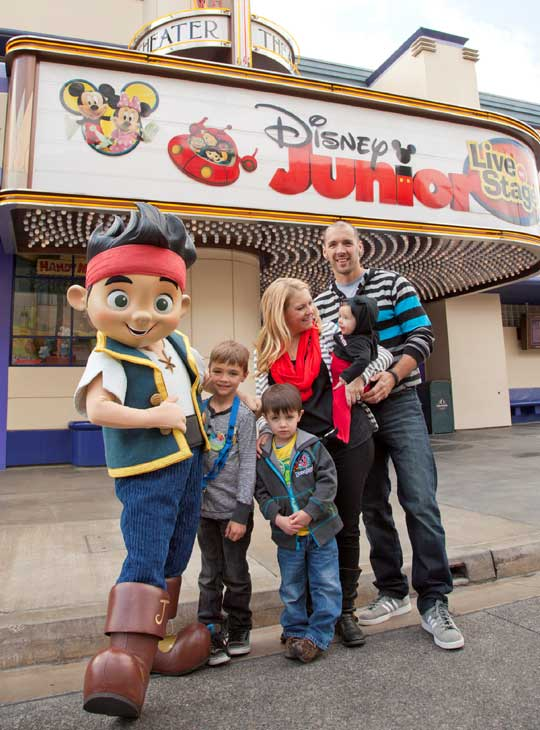 Actress Melissa Joan Hart, her husband, musician Mark Wilkerson, and their sons, Mason (left), 7, Braydon, 5, and Tucker, 6-months,  pose at Disney California Adventure park in Anaheim, Calif., on Saturday, March 9.