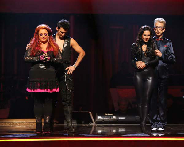 "<div class=""meta ""><span class=""caption-text "">Actor and comedian Andy Dick, his partner Sharna Burgess, singer Wynonna Judd and her partner Tony Dovolani await their fate on 'Dancing With The Stars: The Results Show' on April 2, 2013. (ABC Photo/ Adam Taylor)</span></div>"