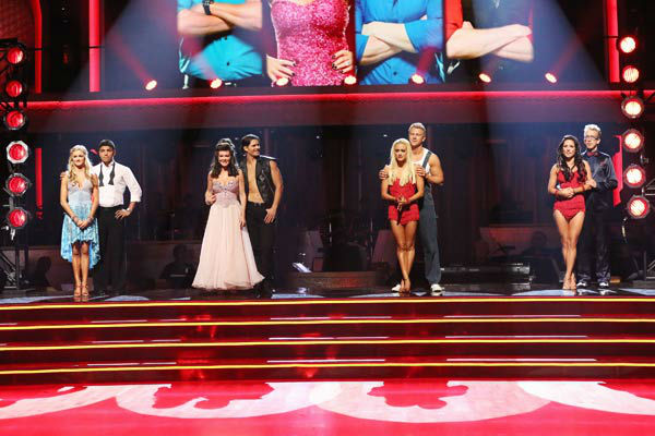 "<div class=""meta ""><span class=""caption-text "">Former 'Bachelor' star Sean Lowe and his partner Peta Murgatroyd await their fate on 'Dancing With The Stars: The Results Show' on April 2, 2013. The pair received 21 out of 30 points from the judges for their Cha Cha Cha on week three of 'Dancing With The Stars,' which aired on April 1, 2013. (ABC Photo/ Adam Taylor)</span></div>"