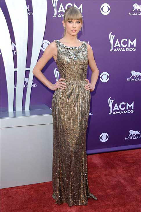 Taylor Swift looked glamorous in a floor-length gold shimmery Dolce and Gabbana gown at the 48th annual Academy of Country Music Awards in Las Vegas, Nevada on April 7, 2013.