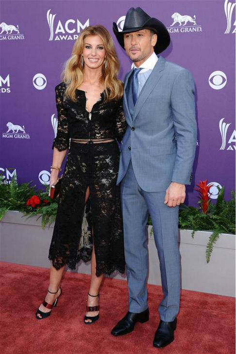 "<div class=""meta ""><span class=""caption-text "">Faith Hill and husband and fellow country star Tim McGraw appear at the 2013 Country Music Awards in Las Vegas on April 7, 2013. The two married in October 1996 and are parents to three daughters.  (Kyle Rover / Startraksphoto.com)</span></div>"