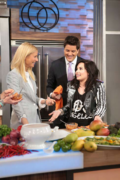 Demi Lovato and Gwyneth Paltrow appear with 'Good Morning America' host Josh Elliott on April 10, 2013.