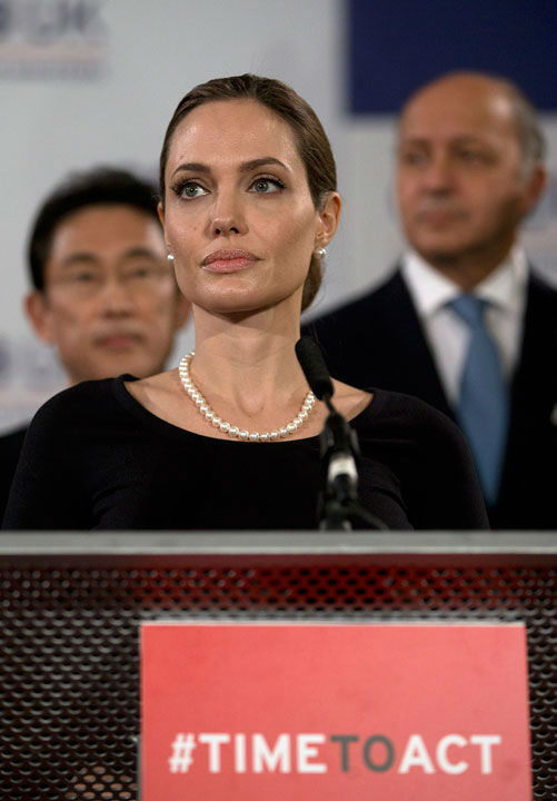 US actress Angelina Jolie, in her role as UN envoy, talks during a news conference regarding sexual violence against women in conflict, during the G8 Foreign Ministers meeting in London on Thursday, April, 11