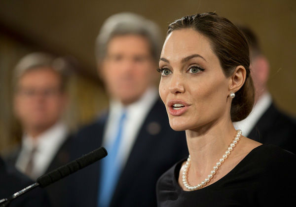 US actress Angelina Jolie, in her role as UN envoy, talks during a news conference regarding sexual violence against women in conflict, during the G8 Foreign Ministers meeting in London on Thursday,