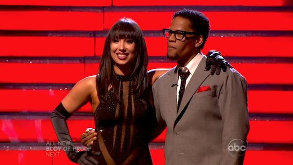 Actor and comedian D.L. Hughley and his partner Cheryl Burke await their fate on 'Dancing With The Stars: The Results Show' on April 16, 2013.