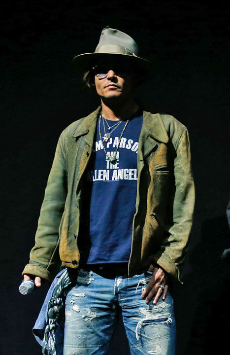 "<div class=""meta ""><span class=""caption-text "">Actor Johnny Depp appears at The Walt Disney Studios Motion Pictures presentation to promote his upcoming film, 'The Lone Ranger' at Caesars Palace during CinemaCon, the official convention of the National Association of Theatre Owners on April 17, 2013 in Las Vegas, Nevada. (Photo/Isaac Brekken/Walt Disney Studios)</span></div>"