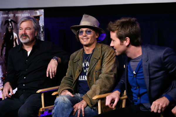 Director Gore Verbinski, actor Johnny Depp and actor Armie Hammer attend &#39;The Lone Ranger&#39; fan event and global trailer launch at the AMC Town Square 18 theatres on April 17, 2013 in Las Vegas, Nevada. <span class=meta>(Photo&#47;Isaac Brekken&#47;Walt Disney Studios)</span>