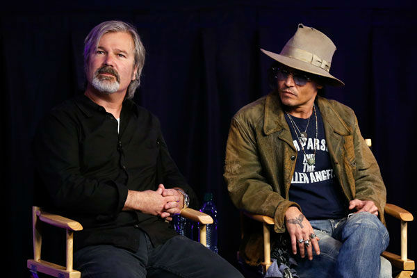 Director Gore Verbinski &#40;L&#41; and actor Johnny Depp attend &#39;The Lone Ranger&#39; fan event and global trailer launch at the AMC Town Square 18 theatres on April 17, 2013 in Las Vegas, Nevada. <span class=meta>(Photo&#47;Isaac Brekken&#47;Walt Disney Studios)</span>