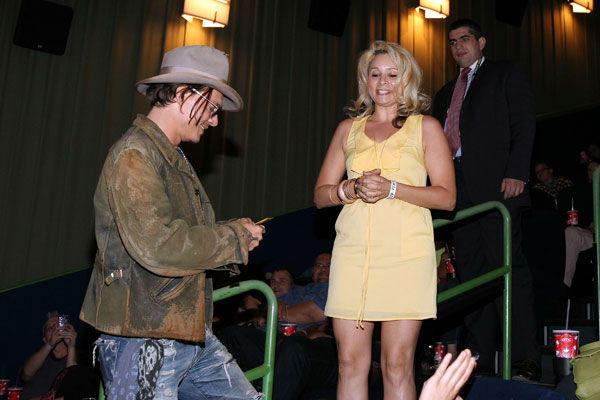 Actor Johnny Depp receives a gift from a fan in the audience at &#39;The Lone Ranger&#39; fan event and global trailer launch at the AMC Town Square 18 theatres on April 17, 2013 in Las Vegas, Nevada. <span class=meta>(Photo&#47;Isaac Brekken&#47;Walt Disney Studios)</span>
