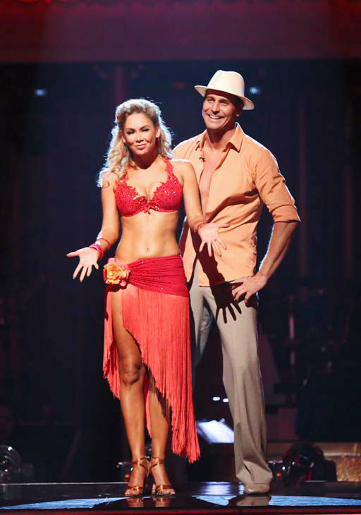 "<div class=""meta ""><span class=""caption-text "">Actor Ingo Rademacher and his partner Kym Johnson await their fate on 'Dancing With The Stars: The Results Show' on April 30, 2013. The pair received 22 out of 30 points from the judges for their Rumba on week 7 of 'Dancing With The Stars,' which aired on April 29, 2013. (ABC Photo/ Adam Taylor)</span></div>"