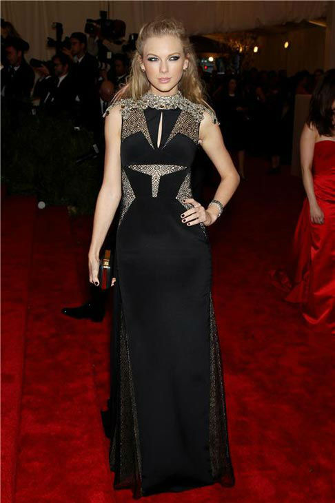 Taylor Swift edged up her look in a J. Mendel stunner for the PUNK: Chaos To Couture Costume Institute Gala at the Metropolitan Museum of Art in New York City on May 6, 2013. <span class=meta>(Marion Curtis &#47; startraksphoto.com)</span>