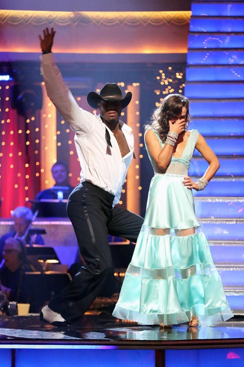 NFL star Jacoby Jones and his partner Karina Smirnoff await their fate on 'Dancing With The Stars: The Results Show' on May 7, 2013.