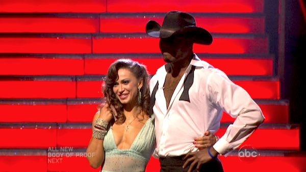 "<div class=""meta ""><span class=""caption-text "">NFL star Jacoby Jones and his partner Karina Smirnoff await their fate on 'Dancing With The Stars: The Results Show' on May 7, 2013.  The pair received 27 out of 30 points from the judges for their Viennese Waltz on week eight of 'Dancing With The Stars,' which aired on May 6, 2013. They also received 25 out of 30 points for their Paso Doble trio, which brought their week's total to 52 out of 60.  (ABC Photo/ Adam Taylor)</span></div>"