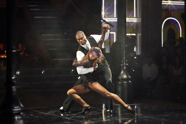 "<div class=""meta image-caption""><div class=""origin-logo origin-image ""><span></span></div><span class=""caption-text"">NFL star Jacoby Jones and partner Karina Smirnoff dance the Argentine Tango on week 9 of 'Dancing With The Stars' on May 13, 2013. They received 30 out of 30 points from the judges. (ABC Photo/ Adam Taylor)</span></div>"
