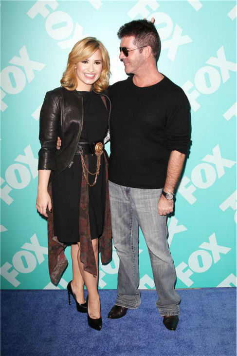 Demi Lovato poses with fellow 'X Factor' judge Simon Cowell at FOX's Upfront Presentation in New York on May 13, 2013.