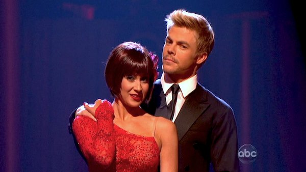 "<div class=""meta ""><span class=""caption-text "">Country singer and 'American Idol' alum Kellie Pickler and Derek Hough await their fate on 'Dancing With The Stars: The Results Show' on May 14, 2013.  The pair received 28 out of 30 points from the judges for their Flamenco routine on week 9 of 'Dancing With The Stars,' which aired on May 13, 2013. They also received 30 out of 30 points for their Argentine Tango, which brought their week's total to 58 out of 60. (ABC Photo / Adam Taylor)</span></div>"