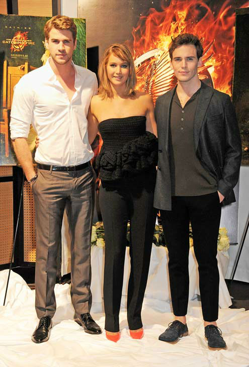 Liam Hemsworth, Jennifer Lawrence and Sam Claflin appear at &#39;The Hunger Games: Catching Fire&#39; photocall at the 2013 Cannes Film Festival at Majestic Barierre on May 18, 2013 in Cannes, France. <span class=meta>(Dave M. Benett &#47; Getty Images for Lionsgate)</span>