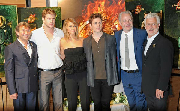 Lionsgate Motion Picture Group Co-Chairman Patrick Wachsberger, cast Liam Hemsworth, Jennifer Lawrence, Sam Claflin, Director Francis Lawrence and Lionsgate Motion Picture Group Co-Chairman Rob Friedman appear at &#39;The Hunger Games: Catching Fire&#39; photocall at the 2013 Cannes Film Festival at Majestic Barierre on May 18, 2013 in Cannes, France. <span class=meta>(Dave M. Benett &#47; Getty Images for Lionsgate)</span>