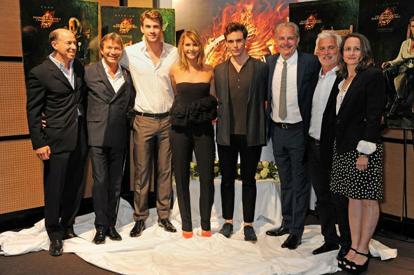 Producer Jon Kilik, Lionsgate Motion Picture Group Co-Chairman Patrick Wachsberger, cast Liam Hemsworth, Jennifer Lawrence and Sam Claflin, Director Francis Lawrence, Lionsgate Motion Picture Group Co-Chairman Robert Friedman and Producer Nina Jacobson appear at &#39;The Hunger Games: Catching Fire&#39; photocall at the 2013 Cannes Film Festival at Majestic Barierre on May 18, 2013 in Cannes, France. <span class=meta>(Dave M. Benett &#47; Getty Images for Lionsgate)</span>