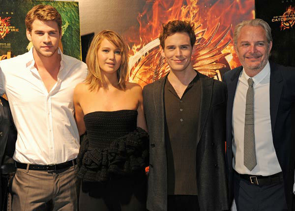 "<div class=""meta image-caption""><div class=""origin-logo origin-image ""><span></span></div><span class=""caption-text"">Cast Liam Hemsworth, Jennifer Lawrence, Sam Claflin and Director Francis Lawrence appear at 'The Hunger Games: Catching Fire' photocall at the 2013 Cannes Film Festival at Majestic Barierre on May 18, 2013 in Cannes, France. (Dave M. Benett / Getty Images for Lionsgate)</span></div>"