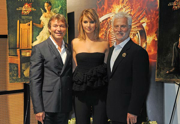 "<div class=""meta image-caption""><div class=""origin-logo origin-image ""><span></span></div><span class=""caption-text"">Lionsgate Motion Picture Group Co-Chairmen Patrick Wachsberger and Robert Friedman and cast member Jennifer Lawrence appear at 'The Hunger Games: Catching Fire' photocall at the 2013 Cannes Film Festival at Majestic Barierre on May 18, 2013 in Cannes, France. (Dave M. Benett / Getty Images for Lionsgate)</span></div>"