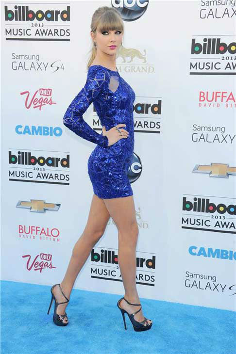 Taylor Swift looked sexy in a blue metallic Zuhair Murad mini dress from the designer&#39;s Pre-Fall 2013 collection at the 2013 Billboard Music Awards in Las Vegas, Nevada on May 19, 2013. <span class=meta>(Stewart Cook &#47; startraksphoto.com)</span>