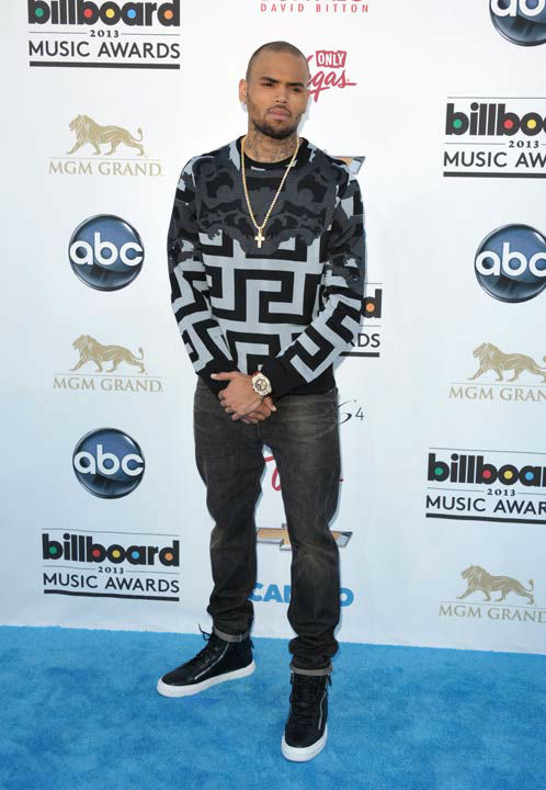 "<div class=""meta image-caption""><div class=""origin-logo origin-image ""><span></span></div><span class=""caption-text"">Chris Brown arrives at the Billboard Music Awards at the MGM Grand Garden Arena on Sunday, May 19, 2013 in Las Vegas.  (Photo/John Shearer / AP)</span></div>"