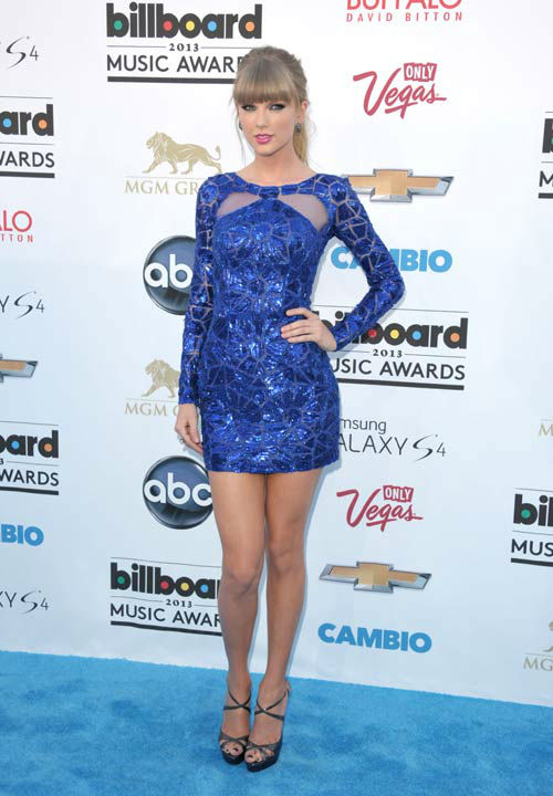 Taylor Swift arrives at the Billboard Music Awards at the MGM Grand Garden Arena on Sunday, May 19, 2013 in Las Vegas.