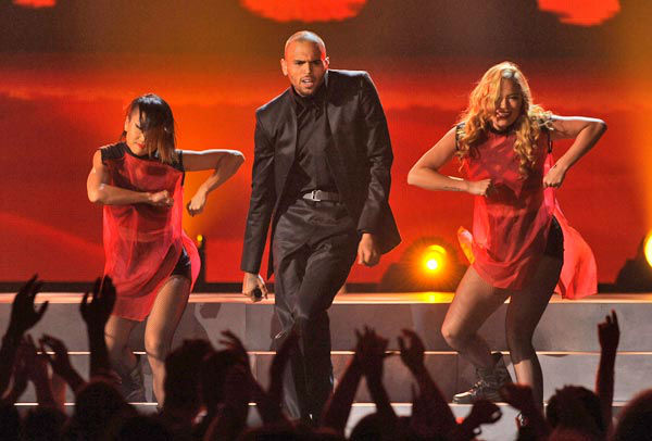 "<div class=""meta ""><span class=""caption-text "">Chris Brown performed at the Billboard Music Awards at the MGM Grand Garden Arena on Sunday, May 19, 2013 in Las Vegas.  The singer and rapper offered up an entertaining performance of his hit single, 'Fine China,' at the award ceremony. He performed the new song while showcasing what helped him rise to fame in the first place -- his dance moves -- as well as a unique ninja fight scene. (Photo/Chris Pizzello / AP)</span></div>"