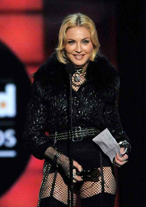 Madonna accepted the award for Top Touring Artist at the Billboard Music Awards at the MGM Grand Garden Arena on Sunday, May 19, 2013 in Las Vegas.  The singer offered up an interesting acceptance speech after receiving the award at the ceremony. After removing her &#39;pretentious&#39; sunglasses -- and thanking will.i.am for holding all of her stuff -- she thanked her crew members from her MDNA tour, her professional dancers and her children. <span class=meta>(Photo&#47;Chris Pizzello &#47; AP)</span>