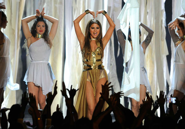 "<div class=""meta ""><span class=""caption-text "">Selena Gomez performed her song 'Come and Get It' at the Billboard Music Awards at the MGM Grand Garden Arena on Sunday, May 19, 2013 in Las Vegas.  The 20-year-old starlet performed her Bollywood-inspired routine on the Billboard main stage -- which was covered in flameless candles -- alongside her back-up dancers. (Photo/Chris Pizzello / AP)</span></div>"