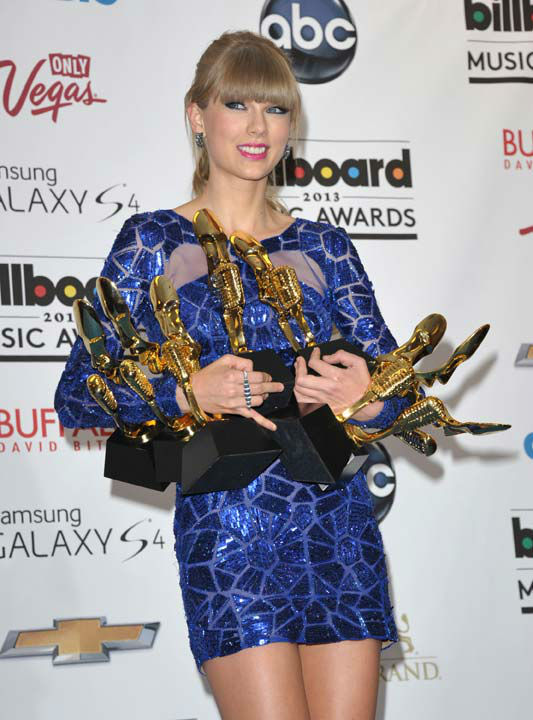 Taylor Swift posed backstage with her awards at the Billboard Music Awards at the MGM Grand Garden Arena on Sunday, May 19, 2013 in Las Vegas.  Swift won awards for Top Female Artist, Top Billboard 200 Artist, Top Digital Songs Artist, Top Country Artist, Top Billboard 200 Album and Top Country Album for &#39;Red,&#39; and Top Country Song for &#39;We Are Never Ever Getting Back Together.&#39; <span class=meta>(Photo&#47;John Shearer &#47; AP)</span>