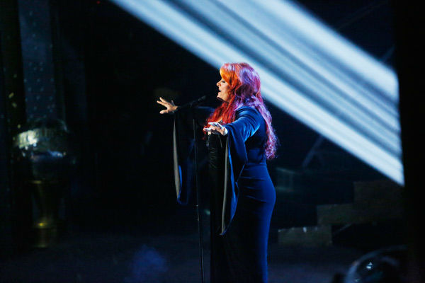"<div class=""meta image-caption""><div class=""origin-logo origin-image ""><span></span></div><span class=""caption-text"">Singer and former contestant Wynonna Judd sings 'I Want To Know What Love Is' on the 'Dancing With The Stars' season 16 finale on May 21, 2013. Pro dancer Peta Murgatroyd and Judd's partner for the season, Tony Dovolani, accompanied her performance.  (ABC Photo/ Kelsey McNeal)</span></div>"
