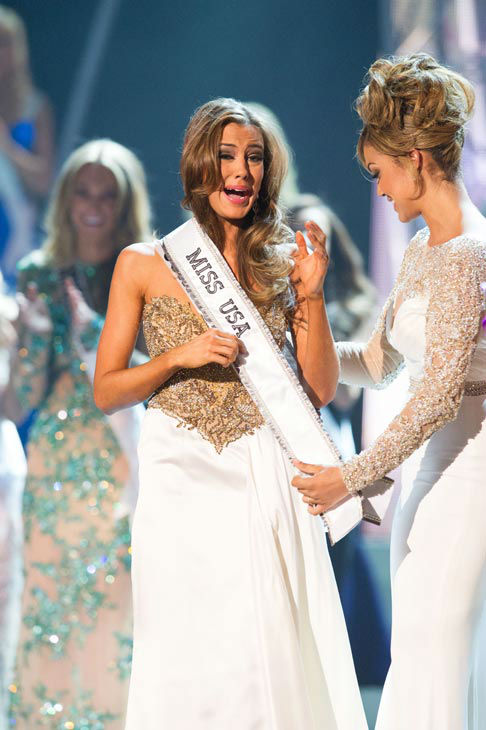 Miss Connecticut USA 2013, Erin Brady of East Hampton, is crowned Miss USA 2013 and gets her new sash from Miss Teen USA 2012 Logan West, at the conclusion of the 2013 MISS USA Competition at PH Live in Las Vegas, Nevada on Sunday June 16, 2013.   <span class=meta>(Miss Universe Organization L.P. &#47; Darren Decker)</span>