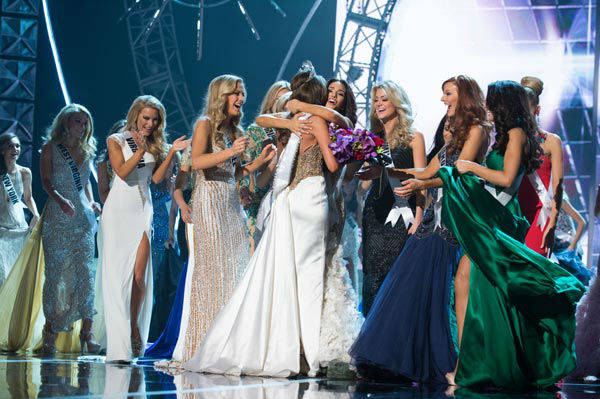 Miss Connecticut USA 2013, Erin Brady of East Hampton, is crowned Miss USA 2013 by Miss USA 2012, and is congratulated by the 2013 Miss USA Delegates at the conclusion of the 2013 MISS USA Competition at PH Live in Las Vegas, Nevada on Sunday June 16, 2013. <span class=meta>(Miss Universe Organization L.P. &#47; Greg Harbaugh)</span>