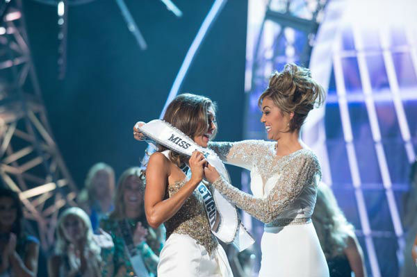 Miss Connecticut USA 2013, Erin Brady of East Hampton, is crowned Miss USA 2013 and gets her new sash from Miss Teen USA 2012 Logan West, at the conclusion of the 2013 MISS USA Competition at PH Live in Las Vegas, Nevada on Sunday June 16, 2013.  <span class=meta>(Miss Universe Organization L.P. &#47; Greg Harbaugh)</span>