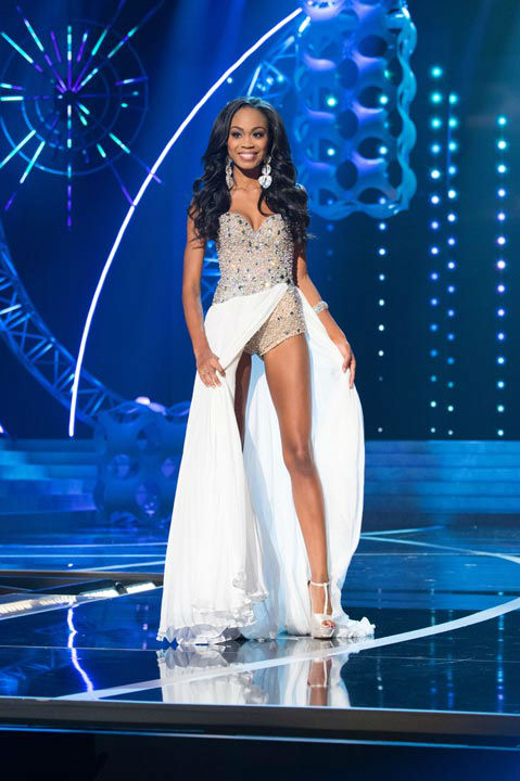 "<div class=""meta image-caption""><div class=""origin-logo origin-image ""><span></span></div><span class=""caption-text"">Miss North Carolina USA 2013, Ashley Love-Mills, competes in her evening gown during the 2013 MISS USA Competition at PH Live in Las Vegas, Nevada on Sunday June 16, 2013.  (Photo/Patrick Prather)</span></div>"