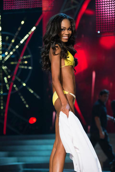 "<div class=""meta ""><span class=""caption-text "">Miss North Carolina USA 2013, Ashley Love-Mills, competes in her ViX Paula Hermanny swimsuit during the 2013 MISS USA Competition at PH Live in Las Vegas, Nevada on Sunday June 16, 2013. (Photo/Richard Harbaugh)</span></div>"