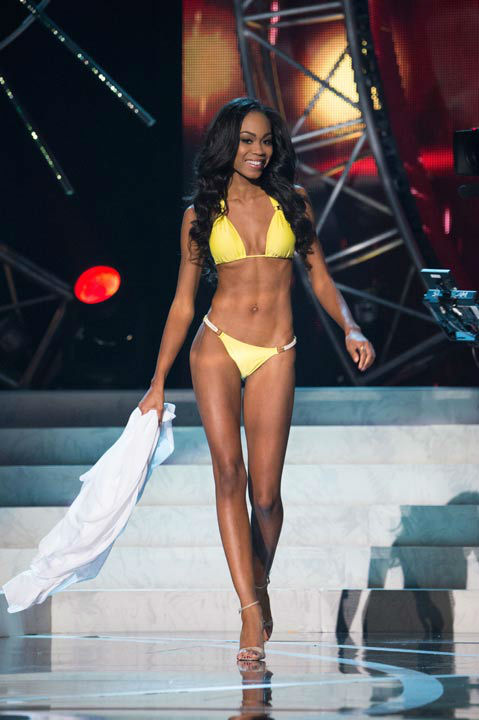 "<div class=""meta image-caption""><div class=""origin-logo origin-image ""><span></span></div><span class=""caption-text"">Miss North Carolina USA 2013, Ashley Love-Mills, competes in her ViX Paula Hermanny swimsuit during the 2013 MISS USA Competition at PH Live in Las Vegas, Nevada on Sunday June 16, 2013. (Photo/Richard Harbaugh)</span></div>"