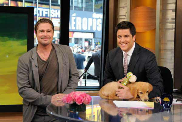 "<div class=""meta image-caption""><div class=""origin-logo origin-image ""><span></span></div><span class=""caption-text"">Brad Pitt appeared with 'Good Morning America' co-host Josh Elliott and a golden retriever puppy on June 17, 2013, while Elliott was promoting the show's 'Dog vs. Dog' contest. (ABC Photo/ Donna Svennevik)</span></div>"