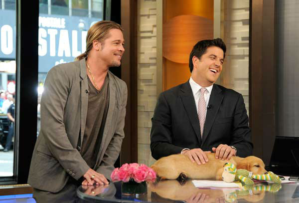 Brad Pitt appeared with 'Good Morning America' co-host Josh Elliott and a golden retriever puppy on June 17, 2013, while Elliott was promoting the show's 'Dog vs. Dog' contest.
