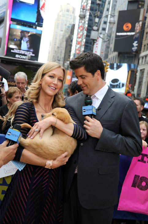 'Good Morning America' co-host Josh Elliott and Lara Spencer appeared with a golden retriever puppy to on June 17, 2013, promote the show's 'Dog vs. Dog' week.