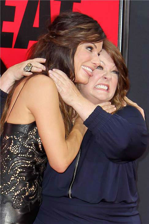 Sandra Bullock jokes around with Melissa McCarthy at the New York City premiere of their film 'The Heat' on June 23, 2013.